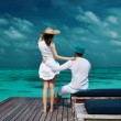 Couple on a beach jetty at Maldives — Stock Photo #59513427