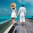 Couple on a beach jetty at Maldives — Stock Photo #59513433