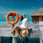 Woman on a beach jetty at Maldives — Stock Photo #59513447