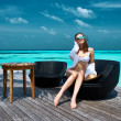 Woman on a beach jetty at Maldives — Stock Photo #59513473