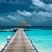Beautiful beach with bungalow — Stock Photo