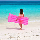 Woman with inflatable raft — Stock Photo