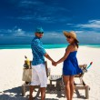 Couple in blue on a beach — Stock Photo #65031965