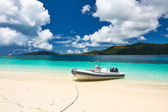 Beach  with inflatable boat — Stock Photo