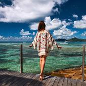 Woman on beach jetty — Stock Photo