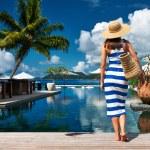 Woman in dress near poolside — Stock Photo #68696773
