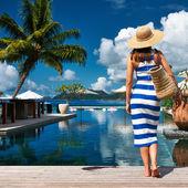 Woman in dress near poolside — Stock Photo