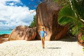 Woman at beach wearing rash guard — Stock Photo