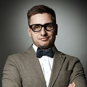 Confident nerd in eyeglasses and bow tie  — Stock Photo
