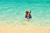Mother and son at the tropical beach — Stock Photo