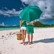Couple in green with umbrella — Foto de Stock   #70284575