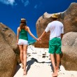 Couple in green on beach at Seychelles — Foto de Stock   #70284605