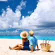 Couple relaxing on tropical beach — Stock Photo #70916701