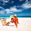 Couple relaxing on tropical beach — Stock Photo #70916705