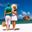 Couple relaxing on tropical beach — Stock Photo #70916707