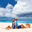 Couple relaxing on tropical beach — Stock Photo #71406275