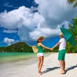 Couple in green on a beach at Seychelles — Stock Photo #72992923