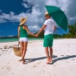 Couple in green on a beach at Seychelles — Stock Photo #72993341
