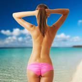 Woman topless on tropical beach at Maldives  — Zdjęcie stockowe
