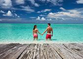 Couple on beach at Maldives — Stock Photo
