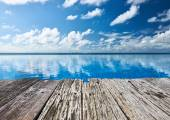 Swimming pool and old wooden pier  — Stock Photo