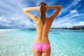 Woman topless on beautiful beach — Stock Photo