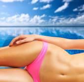 Woman at tropical swimming pool — Stock Photo