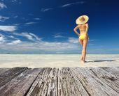 Girl  in bikini on a beach — Stock Photo