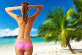 Woman topless on beautiful beach at Seychelles — Stock Photo