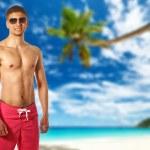 Man on Anse Intendance beach — Stock Photo #79008074