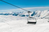 Skilift on ski resort during winter on bright day — Foto Stock