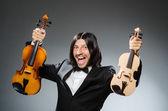 Man violin player in musican concept — Stockfoto