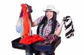 Woman trying to pack too much isolated on white — Stock Photo