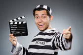 Inmate with movie clapper board — Stock Photo