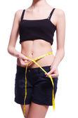 Mladá dívka s centimetr v dietě koncept — Stock fotografie