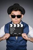 Funny man with movie clapper — Stok fotoğraf