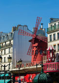 Paris - JUNE 5: Moulin Rouge Cabaret famous red mill on June 5 i — Stock Photo