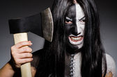 Scary woman with metal axe in halloween concept — Stock Photo