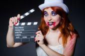 Satan halloween concept with movie clapper board — Stok fotoğraf