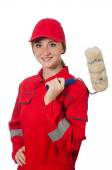Woman painter in red coveralls isolated on the white — Stock Photo