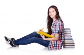 Young student with books isolated on the white — Stockfoto