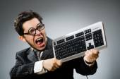 Comouter geek with computer keyboard — Stock Photo