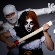 Halloween concept with mummy and woman with axe — Stock Photo #52993585