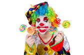 Clown with lollipop isolated on white — Stock Photo