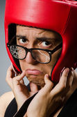 Funny boxer with red gloves against dark background — Stock Photo