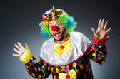 Funny clown in colourful costume — Stock Photo