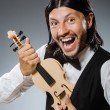 Funny fiddle violin player in musical concept — Stock Photo #53006003