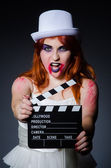 Satan halloween concept with movie clapper board — Stock Photo