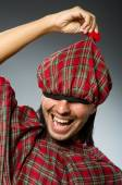 Funny scotsman in traditional clothing — Stock Photo