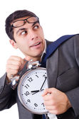 Man with clock afraid to miss deadline isolated on white — Stock Photo